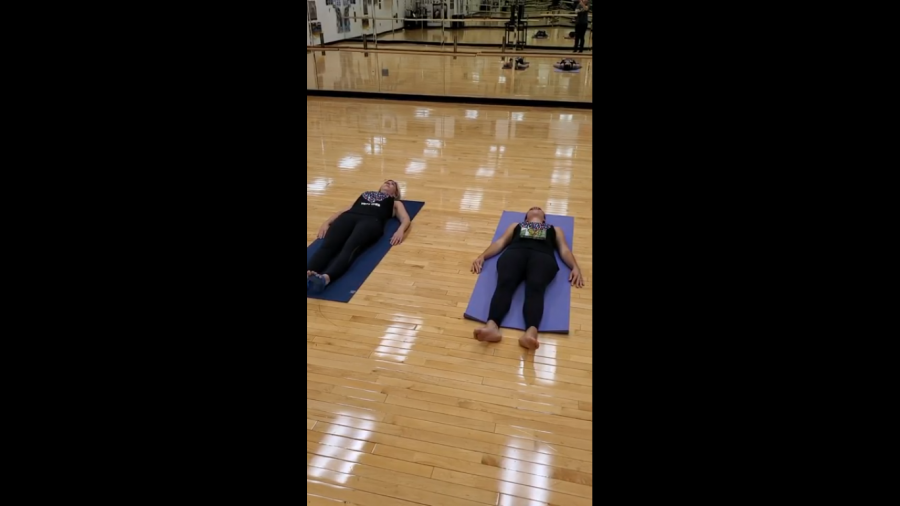 Mrs. Trotter and Mrs. Epstein practice breathing techniques.