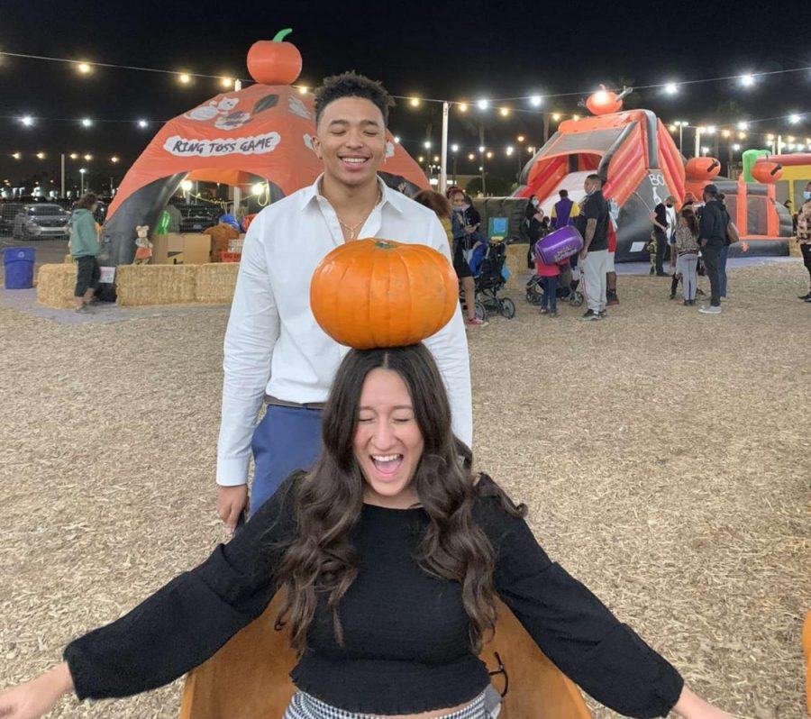 Seniors, Anthony Ford and Kyanna Galvan, celebrate Halloween with a relaxing night at the pumpkin patch.