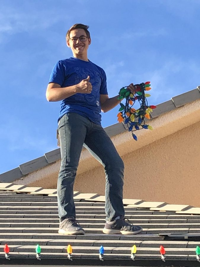 Senior, Jared Richards, as he installs Christmas lights around the Las Vegas valley.