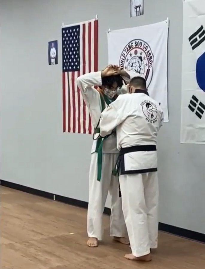 Junior+Elizio+Bodden+receiving+green+belt