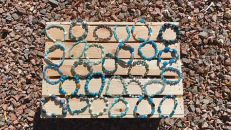 These are teal handmade bracelets, made by Kayla Alia, and they each cost $6.