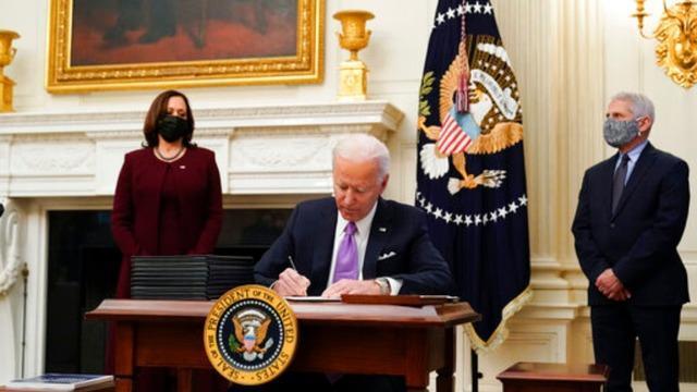 President Joe Biden signing executive orders