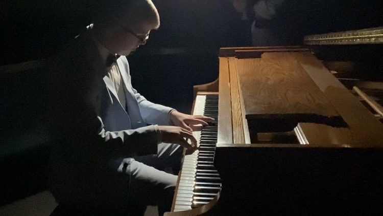 Michael+Dustin+has+been+playing+piano+for+10+years+and+is+shown+here+performing+in+a+recital.