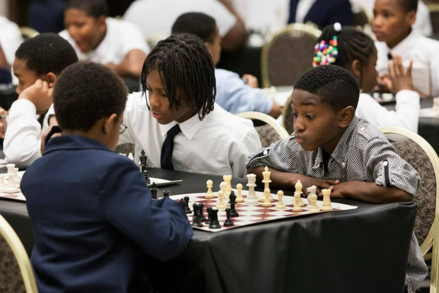 This is a group of students competing against each other in a game of chess.