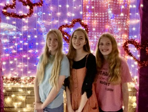 "Abigail Davis and her sisters take pictures at Ethel M ""Lights of Love."" (Masks can be removed momentarily for pictures if proper social distancing protocols are followed)."