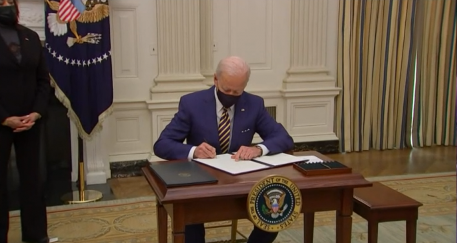 President Joe Biden signing the proposal for the American Rescue Plan
