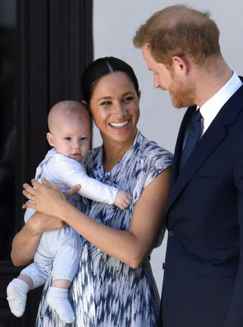 Meghan holding Archie