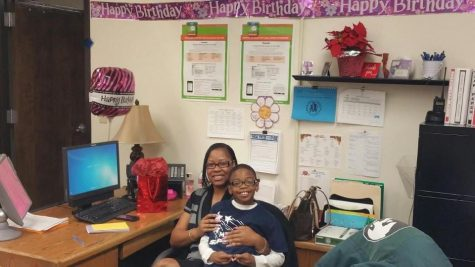 Mrs. Wade-Burns with her son.