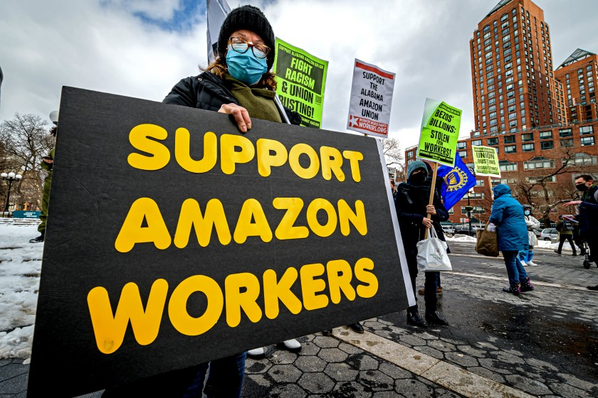 Woman Holding Poster in Support of Amazon Union