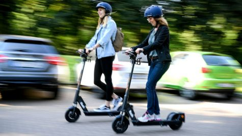 People enjoying scooters as a mode of transportation.