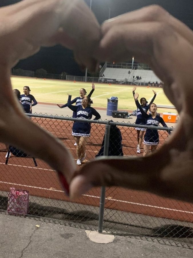 Mia Analisa and her team cheering at a Shadow Ridge football game before the pandemic