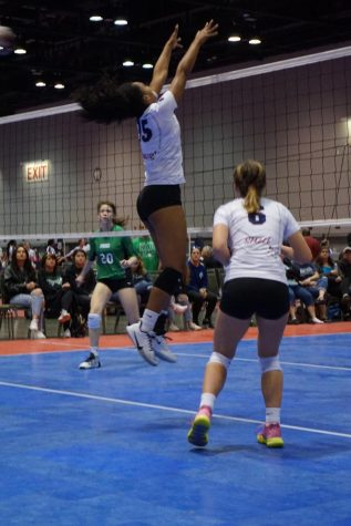 Sanders putting up a solid block during a match.