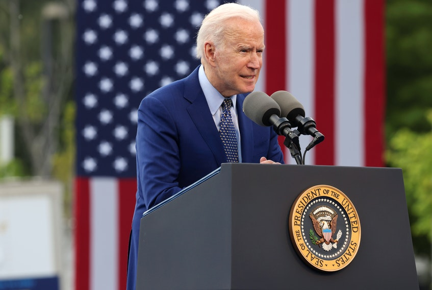 Biden announcing travel ban in India.