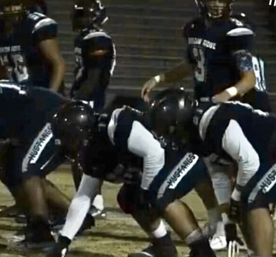 Dover prepares for the play to start so he can block the defense