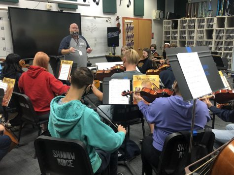 Mr. Richards helps students get ready for the Orchesta concert on Tuesday October 5th.