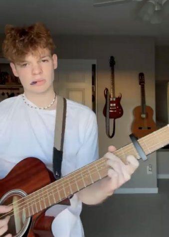 Junior, Luke Hawley playing guitar.