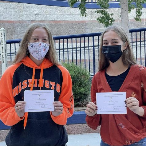 Keira Shepherd (left) and Abigail Davis (right) and their Letters of Commendation.