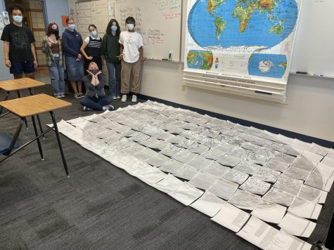 Students complete a world puzzle.